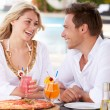 Couple Enjoying Meal In Outdoor Restaurant — Stock Photo #25046239