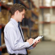 Manager In Warehouse With Clipboard — Stock Photo #25046381