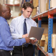 Two Businessmen With Laptop In Warehouse — Stock Photo #25046543