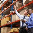 Two Businessmen With Digital Tablet In Warehouse — Stock Photo