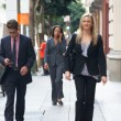 Group Of Businesspeople Walking Along Street — Stock Photo