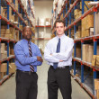 Portrait Of Two Businessmen In Warehouse — Stock Photo #25046709