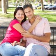Romantic Couple Sitting On Park Bench Together — Stock Photo