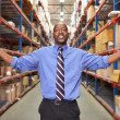 Portrait Of Businessman In Warehouse - Stockfoto