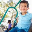 Boy And Girl Playing On Swing In Park — Foto de Stock