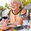 Senior Woman Enjoying Meal In Outdoor Restaurant — Stock Photo