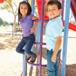 Boy And Girl On Climbing Frame In Park — Stok fotoğraf