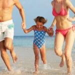 Family Having Fun In Sea On Beach Holiday — Stock Photo