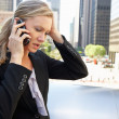 Royalty-Free Stock Photo: Businesswoman Outside Office On Mobile Phone
