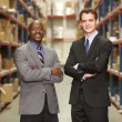 Portrait Of Two Businessmen In Warehouse — Стоковое фото #25047375