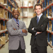Portrait Of Two Businessmen In Warehouse — Stock Photo #25047375