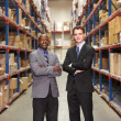 Portrait Of Two Businessmen In Warehouse — Stock Photo