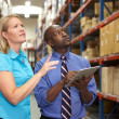 Businesspeople With Digital Tablet In Warehouse — Stock Photo