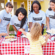 Women And Children Running Charity Bake Sale — Stock Photo