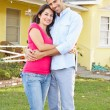 Royalty-Free Stock Photo: Couple Standing Outside Suburban Home