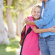Mother And Daughter Walking To School On Suburban Street — Stock Photo #25047769