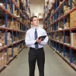 Manager In Warehouse With Clipboard - Photo