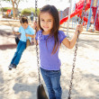 Boy And Girl Playing On Swing In Park — Stock Photo #25047941
