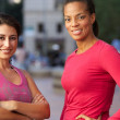 Portrait Of Two Female Runners On Urban Street — Stock Photo #25048023