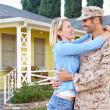 Stock Photo: Wife Welcoming Husband Home On Army Leave