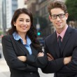 Portrait Of Businessman And Businesswoman Outside Office — Stock Photo #25048113
