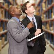 Two Businessmen Having Discussion In Warehouse — Stock Photo #25048197