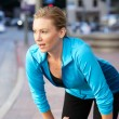 Portrait Of Female Runner On Urban Street - Stockfoto