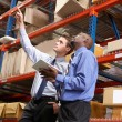 Stock Photo: Two Businessmen With Digital Tablet In Warehouse