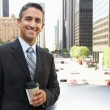 Businessman Drinking Takeaway Coffee Outside Office — Stock Photo #25048259