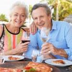 Senior Couple Enjoying Meal In Outdoor Restaurant — Stock Photo