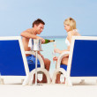 Couple On Beach Relaxing In Chairs And Drinking Champagne — Stock Photo