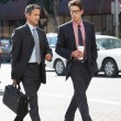 Two Businessman Chatting Whilst Crossing Street — Stock Photo #25048355
