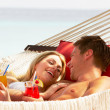 Stock Photo: Romantic Couple Relaxing In Beach Hammock