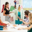 Stock Photo: Meeting In Fashion Design Studio