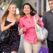 Two Couples With Bored Men Carrying Partners Bags — Stock Photo #25048635
