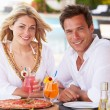 Couple Enjoying Meal In Outdoor Restaurant — Stock Photo #25048689