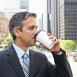 Businessman Drinking Takeaway Coffee Outside Office — Stock Photo