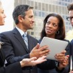 Businessmen And Businesswomen Using Digital Tablet Outside — Stock Photo