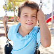 Royalty-Free Stock Photo: Boy On Swing In Park