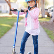 Girl Wearing Safety Helmet Riding Scooter — Stock Photo