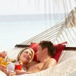 Romantic Couple Relaxing In Beach Hammock — Stock Photo #25048893