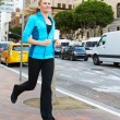Portrait Of Female Runner On Urban Street - ストック写真