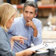 Business Colleagues Working At Desk In Warehouse — Stock Photo #25048987