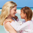 Mother And Daughter Hugging On Beautiful Beach — Stock Photo #25049017