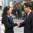Businessman And Businesswoman Shaking Hands In Street — Stock Photo