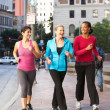 Stock Photo: Group Of Women Power Walking On UrbStreet