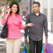 Stok fotoğraf: Fed Up MCarrying Partners Shopping Bags On City Street