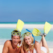 Couple With Snorkels Enjoying Beach Holiday — Stock Photo #25049215