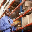 Businessman With Clipboard In Warehouse — Foto de Stock