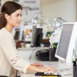 Woman Working At Desk In Busy Creative Office — Stock Photo #25049267